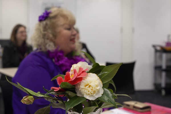 Jen Leahy with camellias at the breakfast.