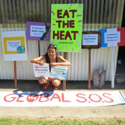 Lan Pham prepares her protest signs for climate march on Raoul Island